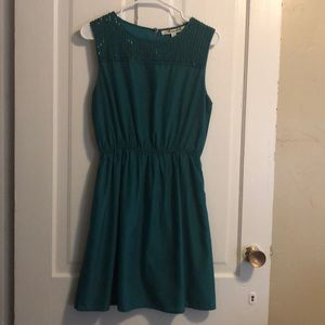 Emerald green dress with sequin neckline